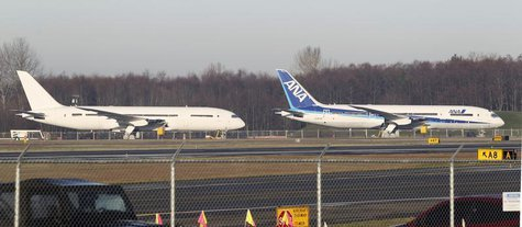 A 787 Dreamliner jet painted in All Nippon Airways (ANA) of Japan livery (R), sits idle with other 787s on the tarmac parking at Paine Field