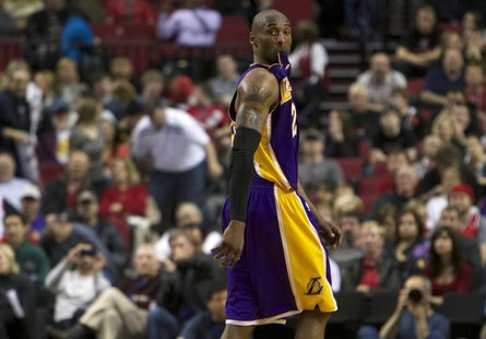 Los Angeles Lakers shooting guard Kobe Bryant (24) watches free throws at end of game against the Portland Trail Blazers during second half