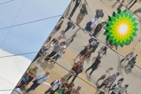 Spectators are seen reflected in a British Petroleum sponsors building in Olympic Park at the London 2012 Paralympic Games September 6, 2012