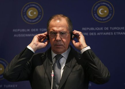 Russia's Foreign Minister Sergei Lavrov adjusts his earphones during a joint news conference with his Turkish counterpart Ahmet Davutoglu (n
