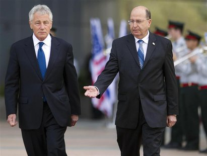 U.S. Defense Secretary Chuck Hagel (L) and his Israeli counterpart Moshe Yaalon walk together during an honour guard ceremony at the Kirya b