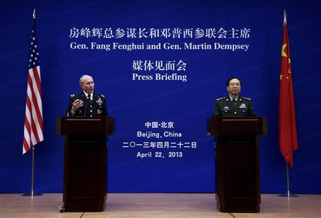 U.S. Joint Chiefs Chairman General Martin Dempsey (L) speaks next to Chief of the general staff of China's People's Liberation Army Fang Fen