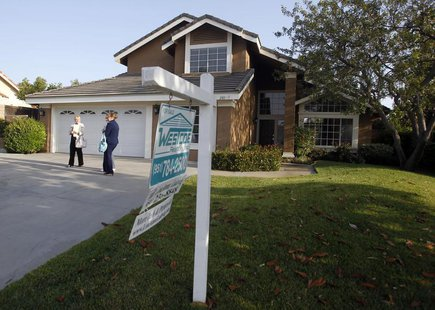 Realtor April Bolin (R) shows a home to Amy (L) and Eddie Deon during an upswing in the housing market, in Riverside, California May 24, 201