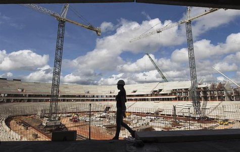 A worker walks inside the Arena da Amazonia, or Vivaldo Lima Stadium, as it is being rebuilt to host the 2014 World Cup, in Manaus April 12,