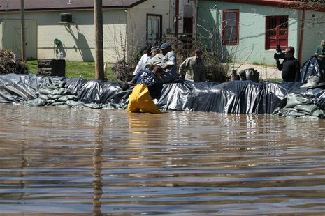Residents and members of the National Guard build a flood wall against the rising Mississippi River in Clarksville, Missouri, in this April