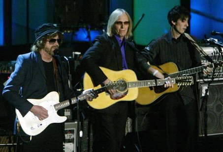 Rock greats Jeff Lynne (L) and Tom Petty play with Dhani Harrison (R), son of ex-Beatle George Harrison, at the 19th Annual Rock and Roll Ha