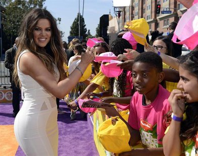 Reality TV star Khloe Kardashian signs autographs at the 2013 Kids Choice Awards in Los Angeles, California March 23, 2013. REUTERS/Phil McC