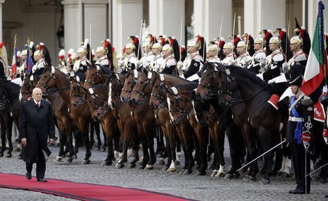 Italy's newly re-elected president Giorgio Napolitano inspects a guard of honor during a welcoming ceremony at the Quirinale palace in Rome,