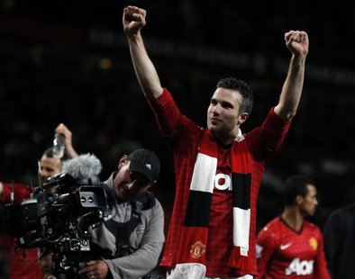 Manchester United's Robin van Persie celebrates after his team clinched the English Premier League soccer title with a win against Aston Vil