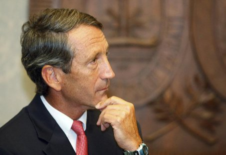 South Carolina Governor Mark Sanford pauses as he addresses the media at a news conference at the State House in Columbia, South Carolina Se