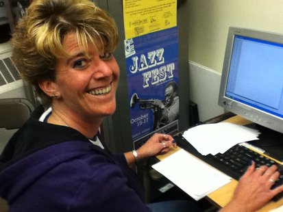 Deb Shell enters teams with correct answers to the questions into the computer.