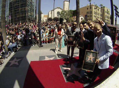 Backstreet Boys (from L-R) A. J. McLean, Howie Dorough, Kevin Richardson, Nick Carter and Brian Littrell pose by their star after it was unv