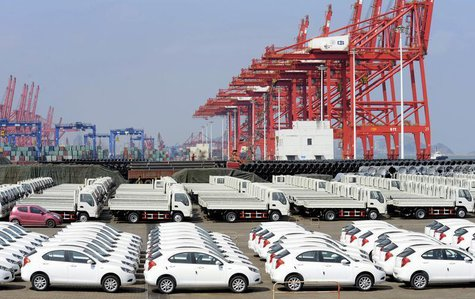 Chinese cars for exporting are parked at a port of Liangyungang, Jiangsu province, March 31, 2013. China's official manufacturing purchasing
