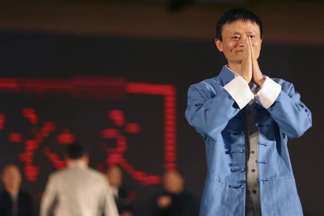 Jack Ma (R), the chairman of China's largest e-commerce firm Alibaba Group, gestures before giving a performance of Tai Chi at the Annual Su