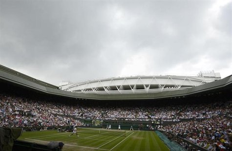 Rainclouds hang over Centre Court before a rain shower during the men's singles final tennis match between Andy Murray of Britain and Roger
