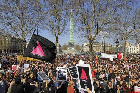 People gather at the Place de la Bastille from groups including Act-Up (AIDS Coalition to Unleash Power) to protest against homophobic attac
