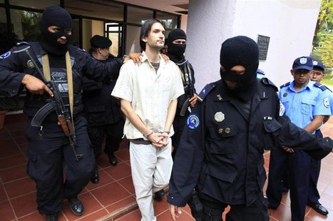 Eric Justin Toth of the U.S. is escorted after a presentation to the media at police headquarters building in Managua April 22, 2013. REUTER