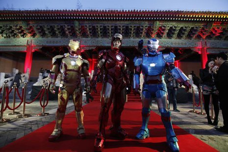 "Performers dressed as Iron Man pose for a photo during a promotional event of the movie ""Iron Man 3"" before its release in China in early Ma"