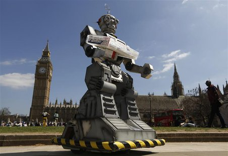A robot is pictured in front of the Houses of Parliament and Westminster Abbey as part of the Campaign to Stop Killer Robots in London April