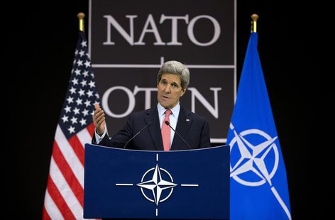 U.S. Secretary of State John Kerry gestures during a news conference at the NATO headquarters in Brussels April 23, 2013. REUTERS/Evan Vucci