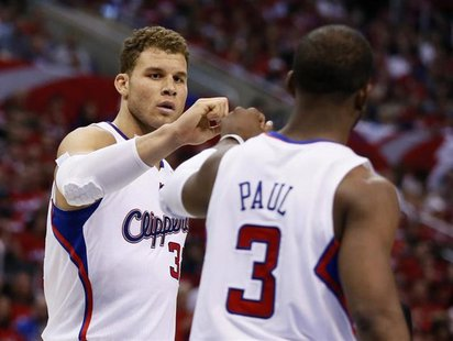 Los Angeles Clippers point guard Chris Paul (3) slaps hands with teammate Blake Griffin (32) during Game 2 of their NBA Western Conference Q