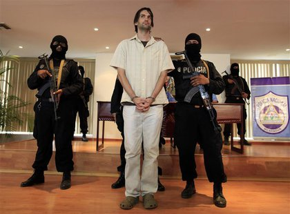 Eric Justin Toth of the U.S. is presented to the media at police headquarters building in Managua April 22, 2013. Toth, a former Washington