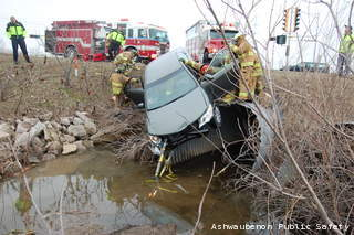 Rescue crews respond to a crash at Ashland Ave. and Cormier St. in Ashwaubenon, April 22, 2013. (courtesy of Ashwaubenon Public Safety)