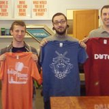 Joey Carty (second from left) displays his winning design, flanked to his left by runners-up Tony Putt and Dan Flemming, at the conclusion of the first Tulip Time Festival T-Shirt Design Contest on Apr. 22, 2013.