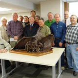 County Board members and others with model of Iron Range Veterans Memorial