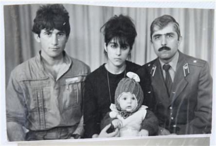 A photo, showing Tamerlan (C, bottom) Tsarnaev, accompanied by his father Anzor (L), mother Zubeidat and uncle Muhamad Suleimanov (R), is seen in this photo courtesy of the Suleimanova family in Makhachkala, April 22, 2013.  Image: REUTERS