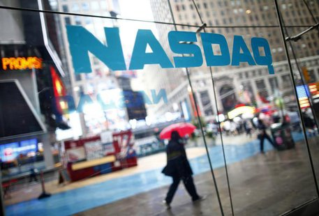 Pedestrians walk past the NASDAQ MarketSite in New York's Times Square in this June 4, 2012 file photo. REUTERS/Eric Thayer/Files (
