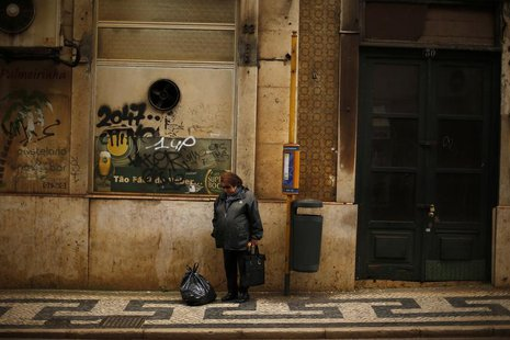 A woman waits for bus in downtown Lisbon April 8, 2013. REUTERS/Rafael Marchante
