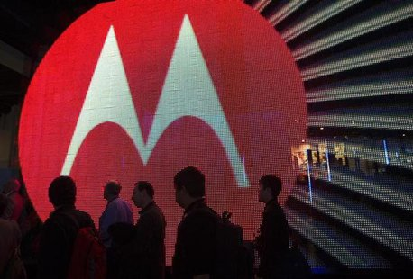 People pass by the Motorola booth during the 2011 International Consumer Electronics Show (CES) in Las Vegas, Nevada January 7, 2011. REUTER
