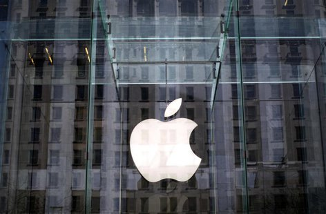 The Apple logo hangs inside the glass entrance to the Apple Store on 5th Avenue in New York City, in this April 4, 2013, file photo. REUTERS