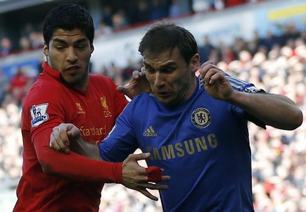 Chelsea's Branislav Ivanovic (R) challenges Liverpool's Luis Suarez during their English Premier League soccer match at Anfield in Liverpool