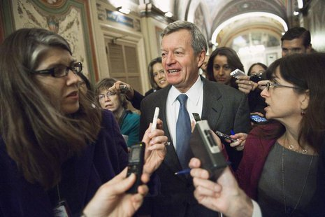 U.S. Senator Max Baucus (D-MT) (C) talks to reporters after meeting with his fellow Democratic members of the 'super committee' at the U.S.