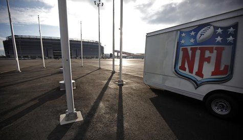 The NFL logo is seen on a trailer parked near the New Meadowlands Stadium where the New York Jets and New York Giants NFL football teams pla