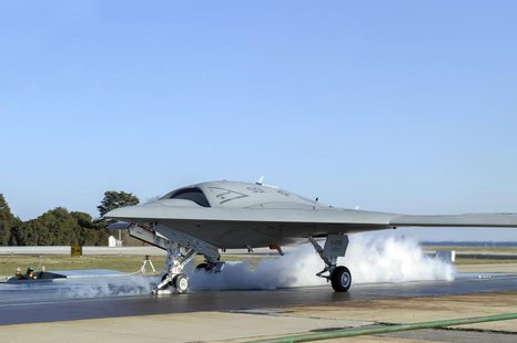 A launch crew prepares a Northrop Grumman X-47B Unmanned Combat Air System (UCAS) demonstrator for its first land-based catapult launch in t