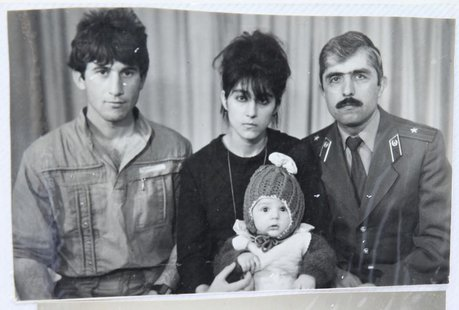 A photo, showing Tamerlan (C, bottom) Tsarnaev, accompanied by his father Anzor (L), mother Zubeidat and uncle Muhamad Suleimanov (R), is se