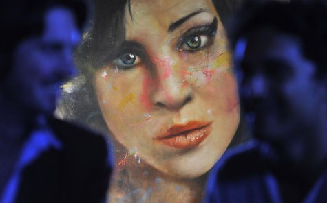 A painting 'Amy' by British artist Johan Andersson is seen hanging at a pub in central London August 23, 2011. REUTERS/Toby Melville