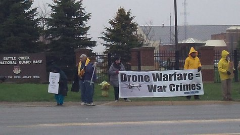 About a dozen protesters appeared in the cold and snow to object to the deployment of the Drone Control Center in Battle Creek