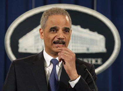 U.S. Attorney General Eric Holder speaks at a news conference to announce a major financial fraud enforcement action at the Justice Departme