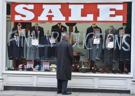 A man looks into a shop window in central London February 27, 2013. REUTERS/Toby Melville