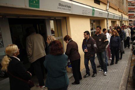 People wait in line to enter a government-run employment office in Malaga, southern Spain March 4, 2013. REUTERS/Jon Nazca