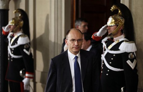 Deputy leader of Italy's centre-left Democratic Party (PD) Enrico Letta arrives to speak to reporters at the Quirinale Palace in Rome April