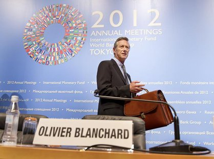 International Monetary Fund's Economic Counsellor and Director of Research Department Olivier Blanchard enters the news briefing on the Worl