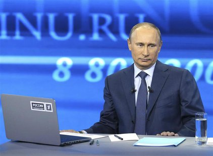 Russian President Vladimir Putin takes part in a live broadcast nationwide phone-in in Moscow April 25, 2013. Putin played down differences