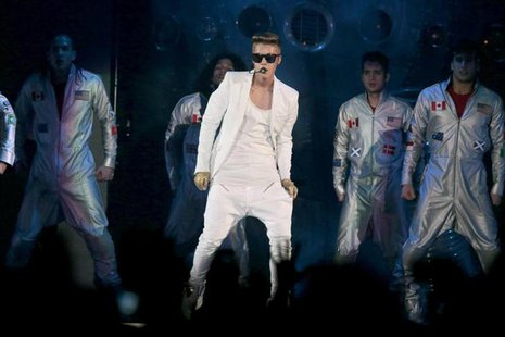 Canadian singer Justin Bieber performs on stage during the first of three concerts at Telenor Arena in Oslo April 16, 2013. REUTERS/Lise Ase