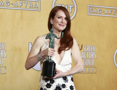 "Julianne Moore holds her award for outstanding female actor in a TV movie or miniseries for ""Game Change"" backstage at the 19th annual Scree"