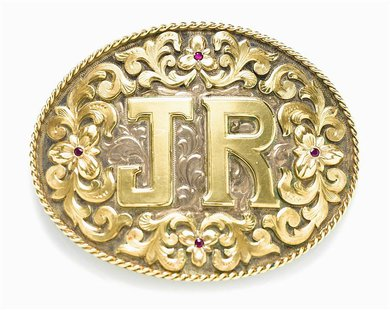 "A ruby-adorned silver and gold belt buckle from the U.S. television drama ""Dallas"" owned by the late actor Larry Hagman is shown in this pub"